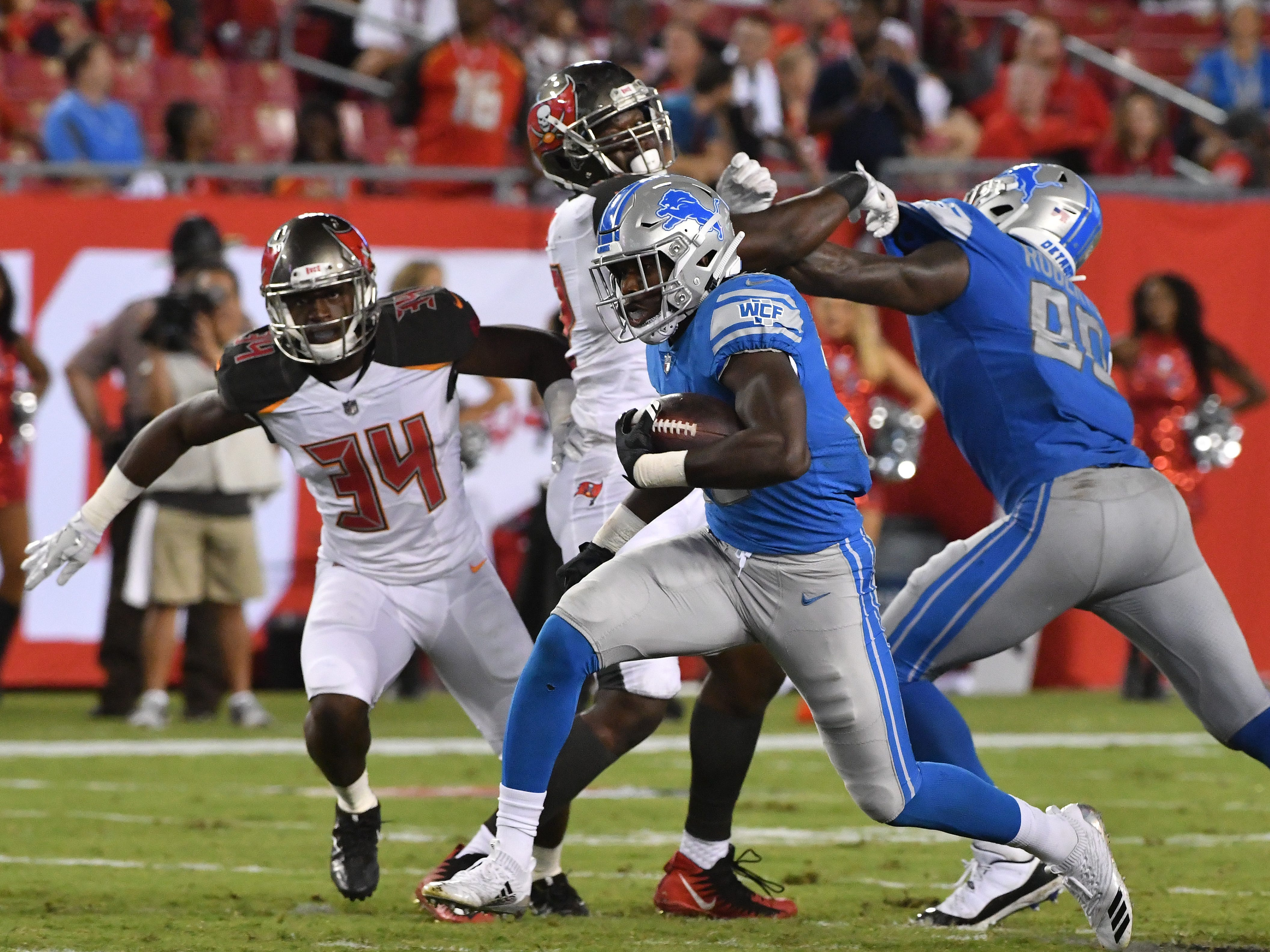 Lions rookie running back Kerryon Johnson gets a block and heads up field in the third quarter.