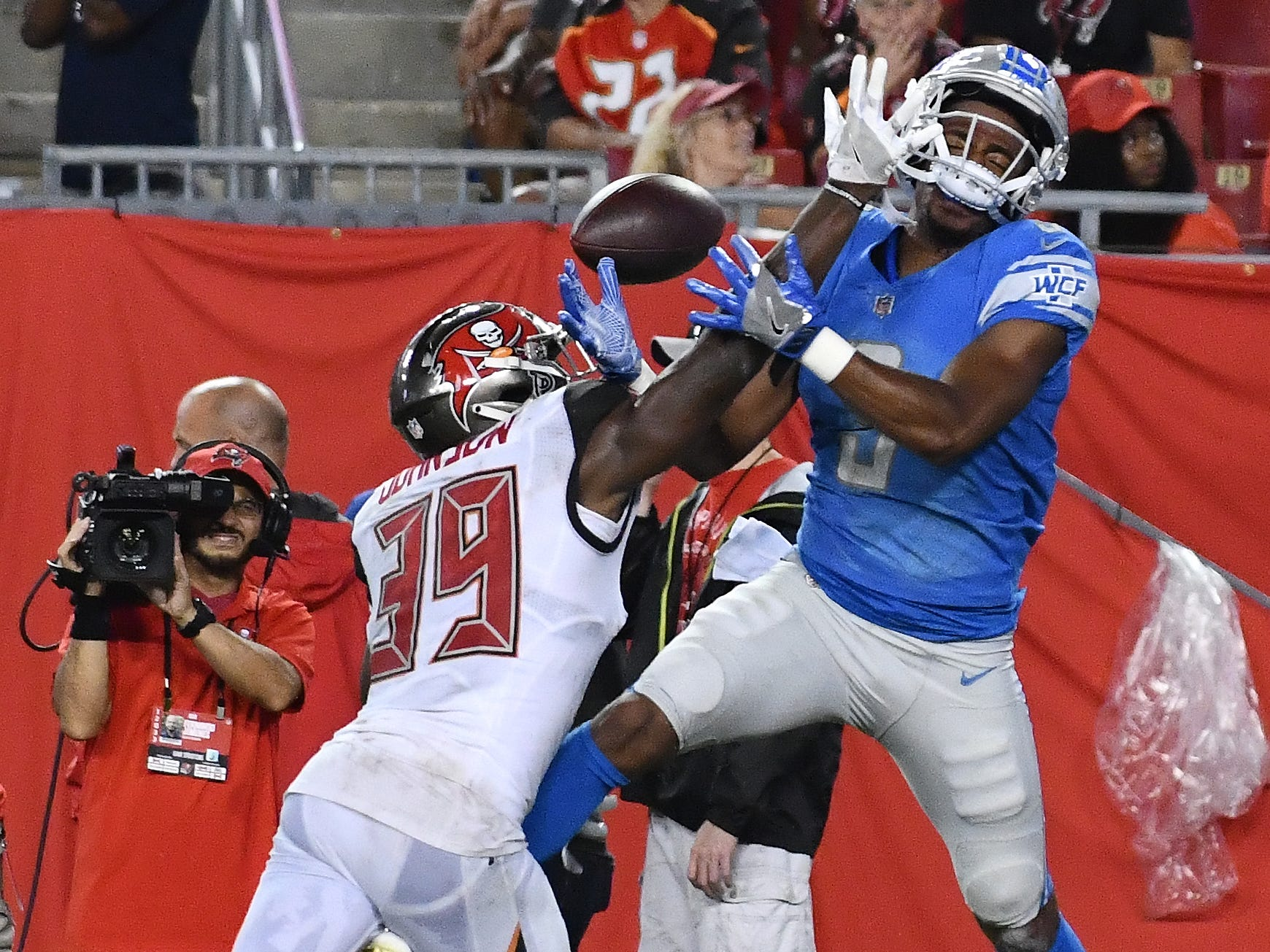 Buccaneers' Isiah Johnson breaks up a pass intended for Lions' Brian Brown in the fourth quarter.