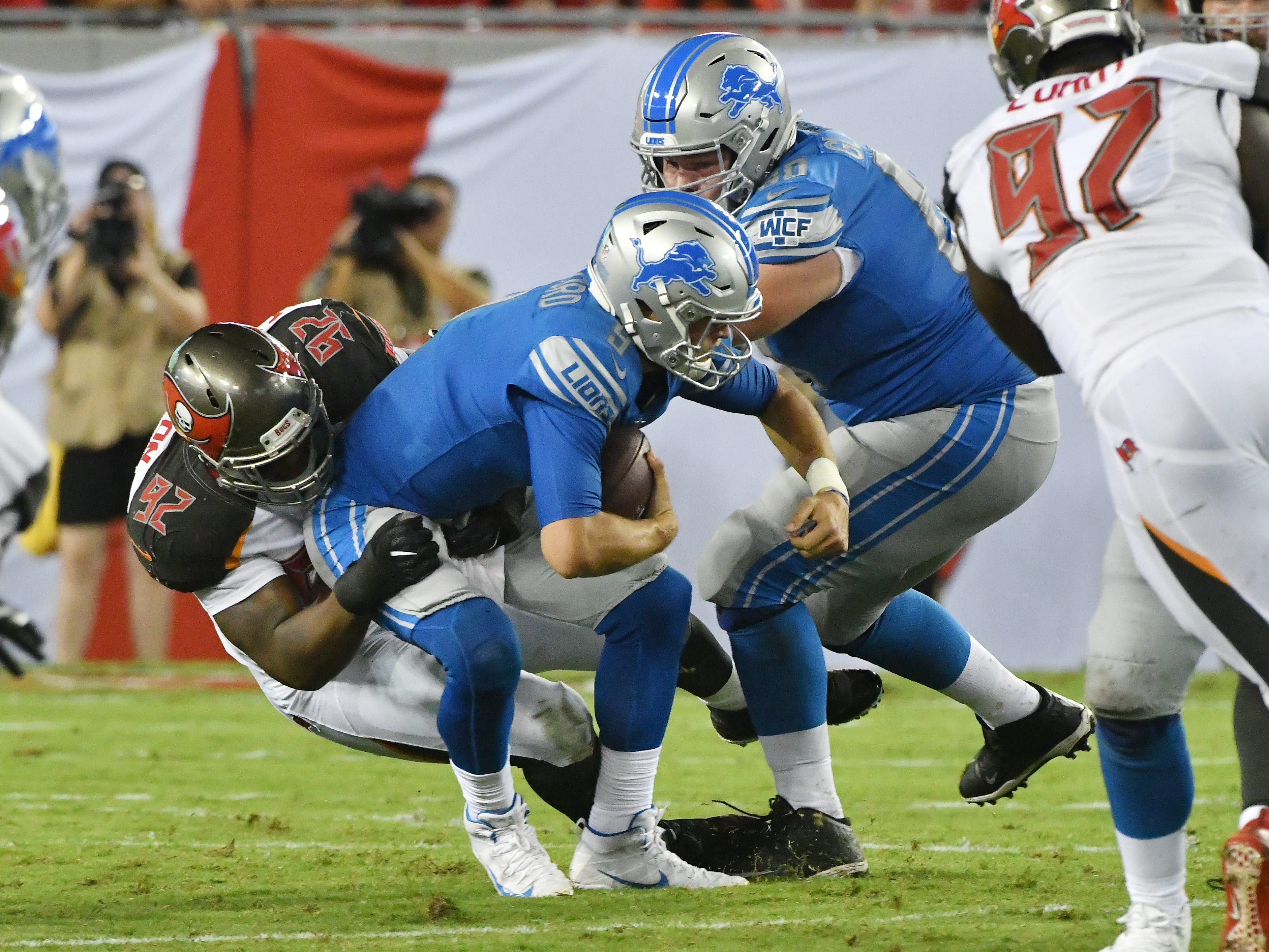 Buccaneers' William Gholstron gets past Lions' Graham Glasgow and sacks Lions quarterback Matthew Stafford in the second quarter.