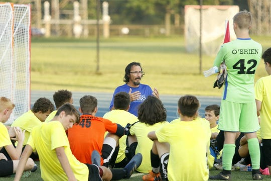 Horseheads coach Mark Mucci talks to his players at halftime of a scrimmage Aug. 24 against Elmira Notre Dame at Brewer Memorial Stadium.