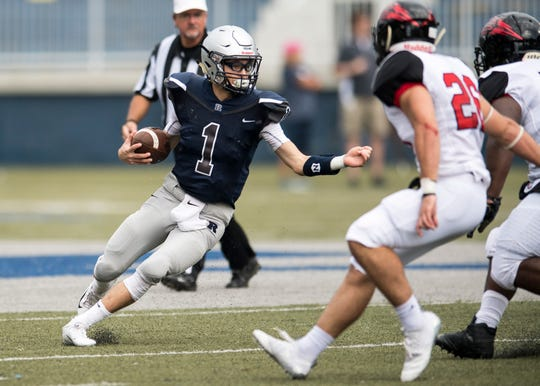 Reitz's Quarterback Eli Wiethop (1)  carries the ball against the Owensboro Red Devils during a game at the Reitz Bowl Friday August 24, 2018.