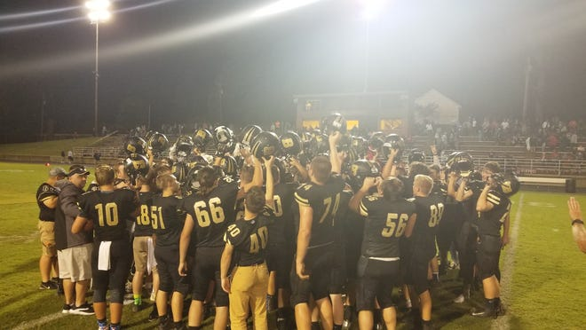 Boonville High School football breaks down a huddle after defeating Vincennes Lincoln, 40-26, on Friday night at Bennett Field.