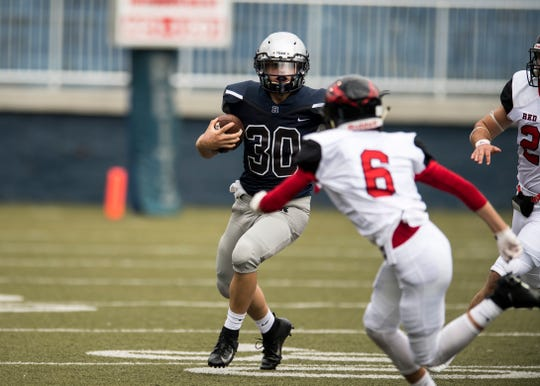 Reitz's Alex Mitchell (30) carries the ball against the Owensboro Red Devils during a game at the Reitz Bowl Friday August 24, 2018.
