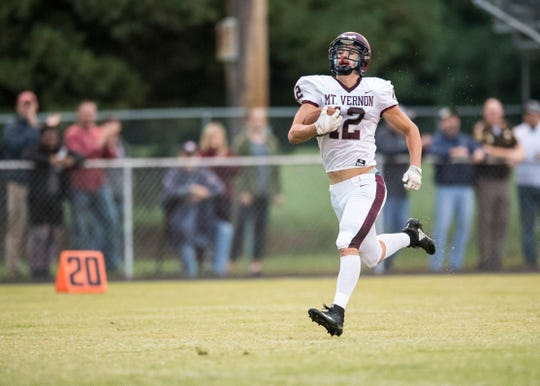 Sam Thomas carries the ball for Mount Vernon in the Wildcats' 64-49 win over North Posey. Thomas rushed for 287 yards and scored eight touchdowns.