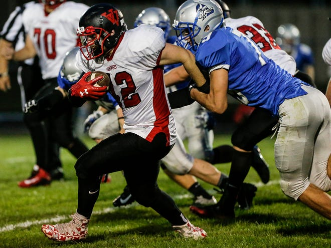 A Valders player pulls away from Winnebago Lutheran Academy's Benji Cole during an Aug. 24 game in Fond du Lac.