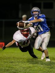 Winnebago Lutheran's Tate Manke reaches out for a pass as Valders' Angel Tremillo moves in for a tackle during an Aug. 24 game. Winnebago Lutheran is 1-1 in the Flyway.