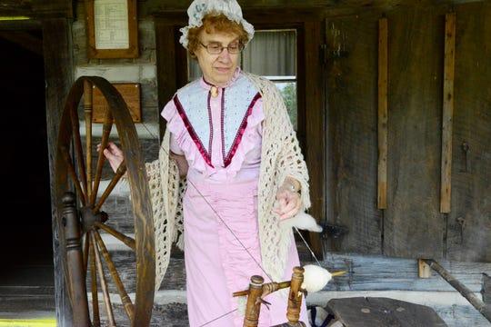 Jan Jordan of Bellevue spins wool into yarn at the Sandusky County Fair on Saturday.