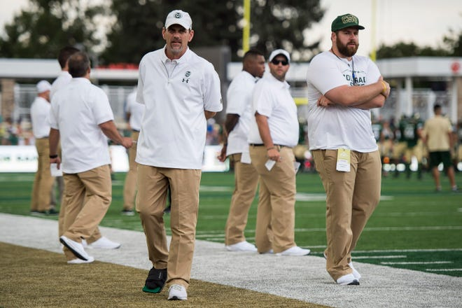Colorado State University head coach Mike Bobo look on from the sidelines with a walking boot on before a game against the University of Hawaii Rainbow Warriors on Saturday, Aug. 25, 2018, at Canvas Stadium in Fort Collins, Colo.