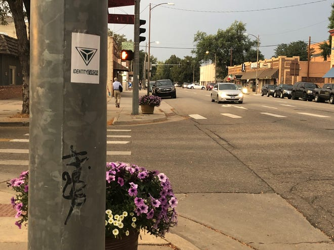 Identity Evropa's logo is displayed on a light pole in downtown Loveland on Friday.