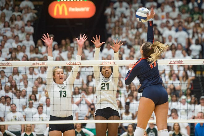 CSU's Kirstie Hillyer, left, had eight blocks in a 3-1 win over San Diego State on Thursday.