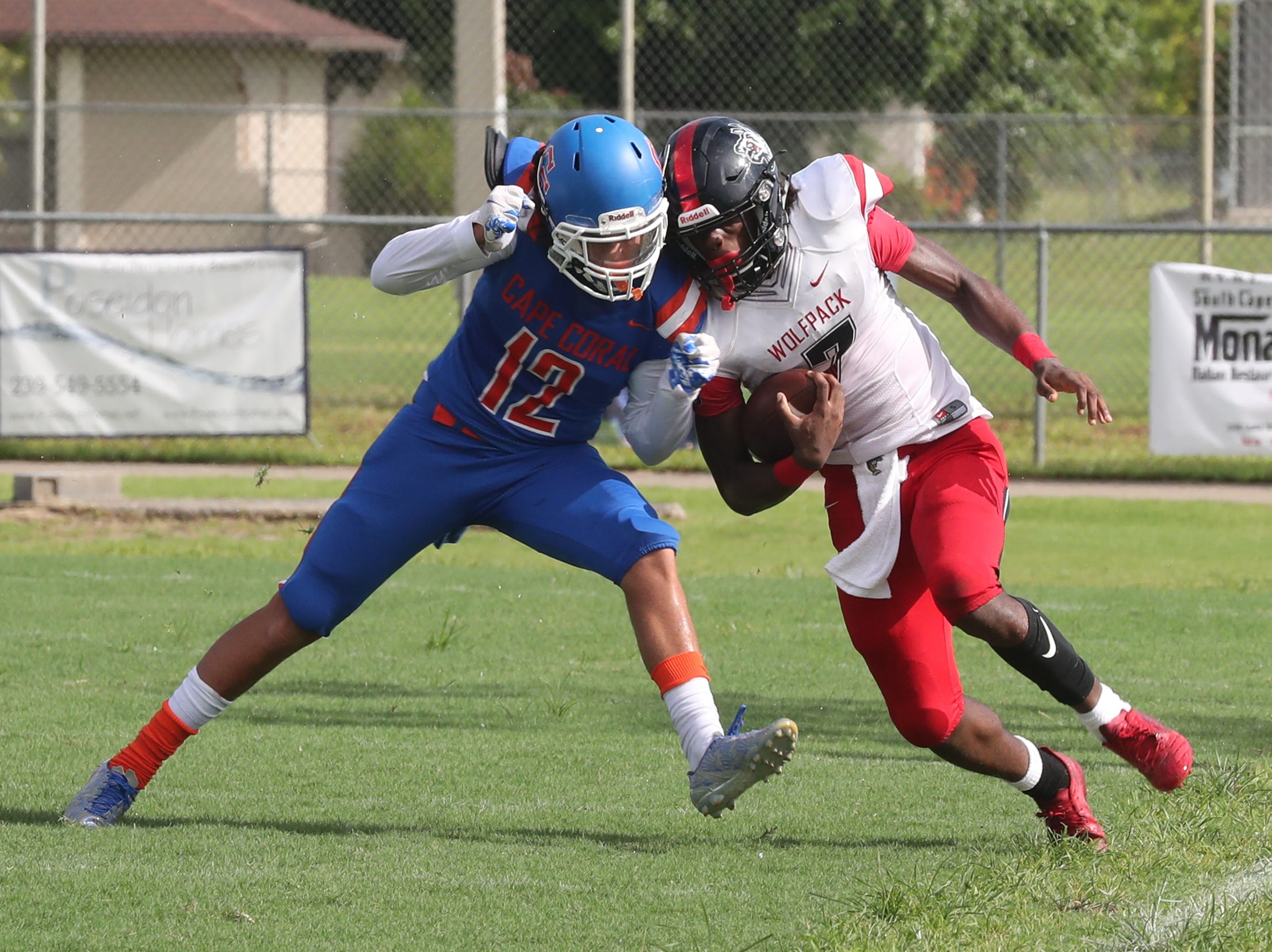 Anthony Arsenault , Cape Coral High School hits Freddie Ward, South Fort Myers, out of bounds. Cape beat South Fort Myers in their Saturday morning game.