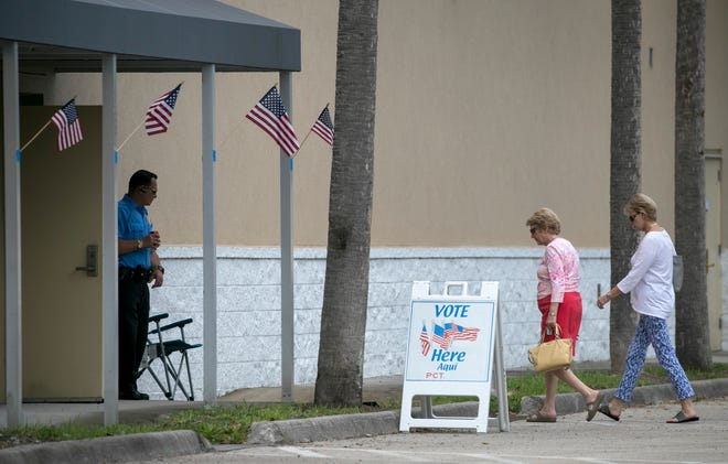 Voters walk into the Lee County Elections Center on Saturday, August 25, 2018, to cast their ballots on the final day of early voting.