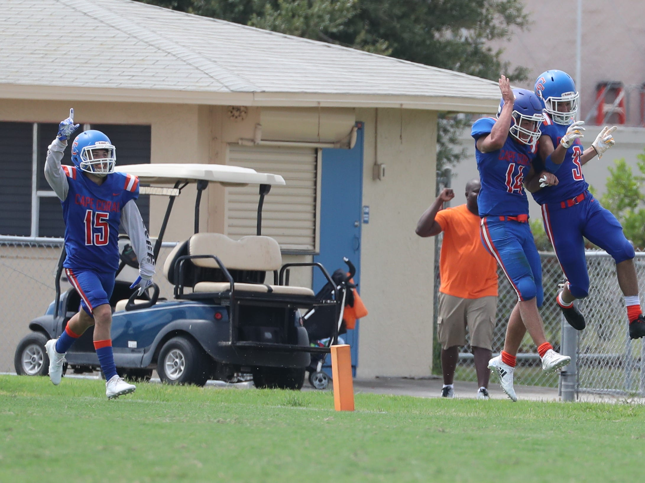 Jaydin Feliz Cape Coral High School grabbed the pass over the top of Tommy Beemer, South Fort Myers, and goes on to score. Teammates, (14)Parker Odell and (15)Dylan Shipley celebrate with him. Cape beat South Fort Myers in their Saturday morning game.
