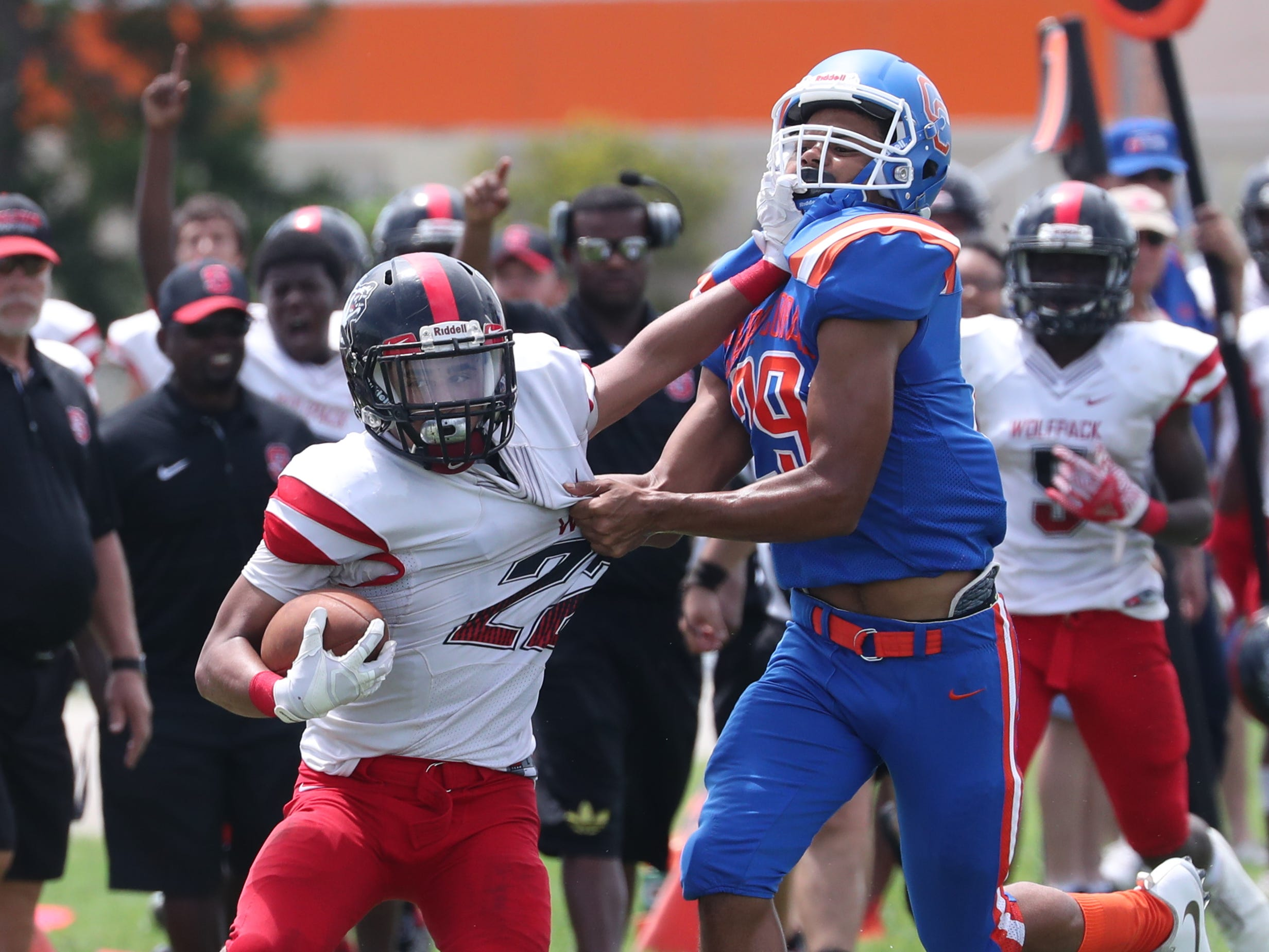 Brodrick Hamilton Cape Coral High School tries to stop Marco Cardona, South Fort Myers, from gaining ground. Cape beat South Fort Myers in their Saturday morning game.