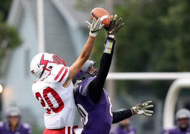 Seymour's Del Wendt breaks up a pass intended for Green Bay West's Jefferson Cooper-Holmes on Friday at West.
