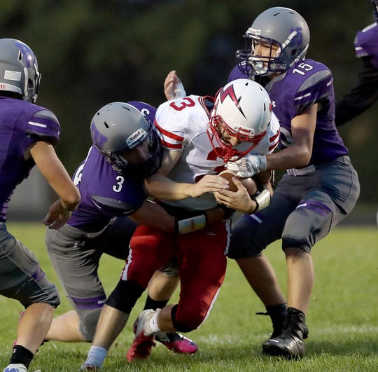 Seymour quarterback Hunter Clark gets sacked against Green Bay West on Friday. Clark took over at the position after starter Peyton VanDeHei left with a shoulder injury.