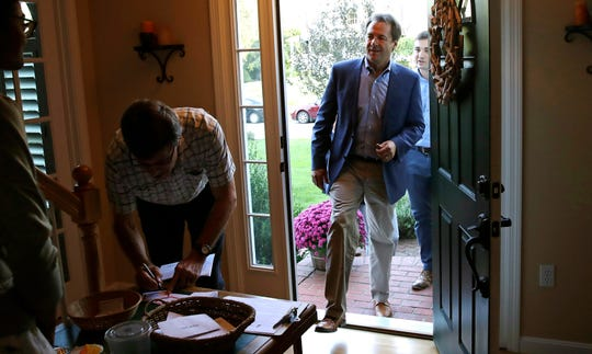 Montana Gov. Steve Bullock arrives for a house party supporting Democratic candidates in Hampton, N.H., Friday, Aug. 24, 2018. Bullock is visiting New Hampshire this weekend as he explores a possible 2020 presidential bid. (AP Photo/Charles Krupa)