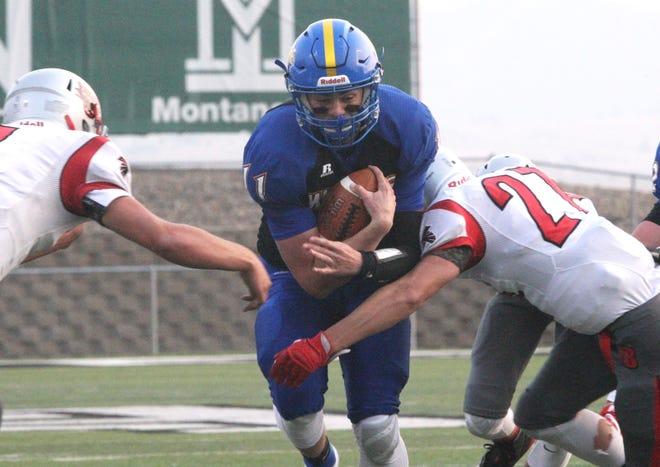 Great Falls Central's Noah Ambuehl battles through the Twin Bridges' defense during an 8-Man football game last August at Montana Tech's Bob Green Field.