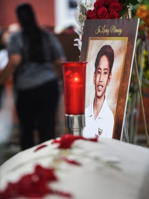 Family, friends, classmates and others pay their last respects for Father Duenas Memorial School student Xavier Akima during a public viewing at the Dulce Nombre de Maria Cathedral Basilica in Hagåtña on Saturday, Aug. 25, 2018. Akima, 15, lost his life after drowning in a flash flood, created by heavy rains, while he and eight others were hiking in the area of San Carlos Falls on Aug. 11.