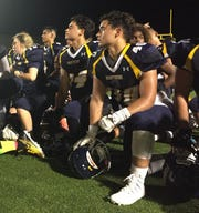 The Guam High Panthers take a knee after their 52-0 win over the Tiyan High Titans in the opening weekend of the IIAAG High School Football season Aug. 25 at Guam High.