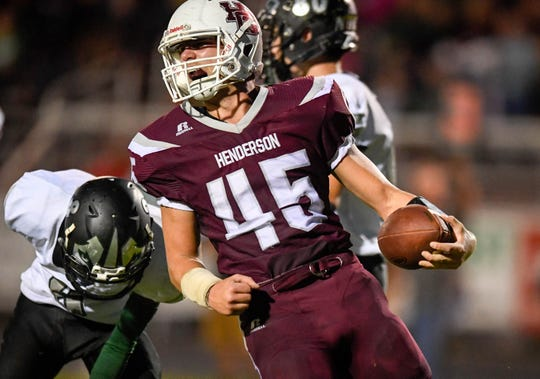 Henderson's Ian Pitt (45) reacts to scoring a touchdown as the Evansville North Huskies play the Henderson County Colonels at Colonel Field Friday, August 24, 2018.