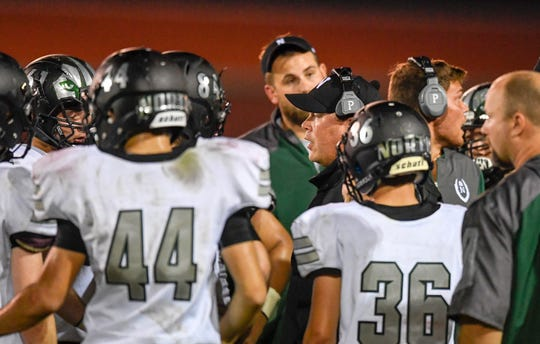 North head coach Joey Paridaen talks to his team during a time out as the Evansville North Huskies play the Henderson County Colonels at Colonel Field Friday, August 24, 2018.