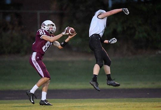 Nick Cissell (81) makes a touchdown catch post North's Trevor Rumsey (4)  as Henderson's  waits for the catch as the Evansville North Huskies play the Henderson County Colonels at Colonel Field Friday, August 24, 2018.