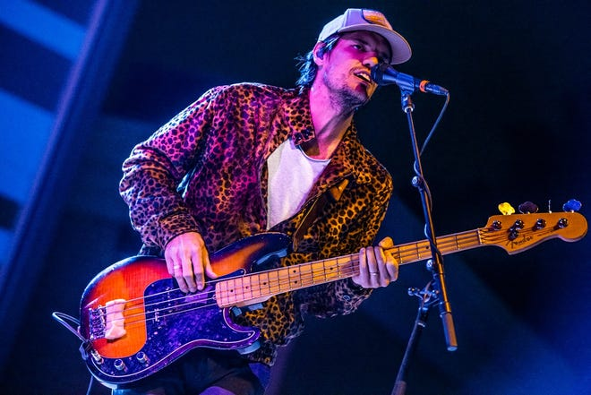 Bass player Zak Appleby performs with Houndmouth Friday at the renovated Nickel Plate District Amphitheater.