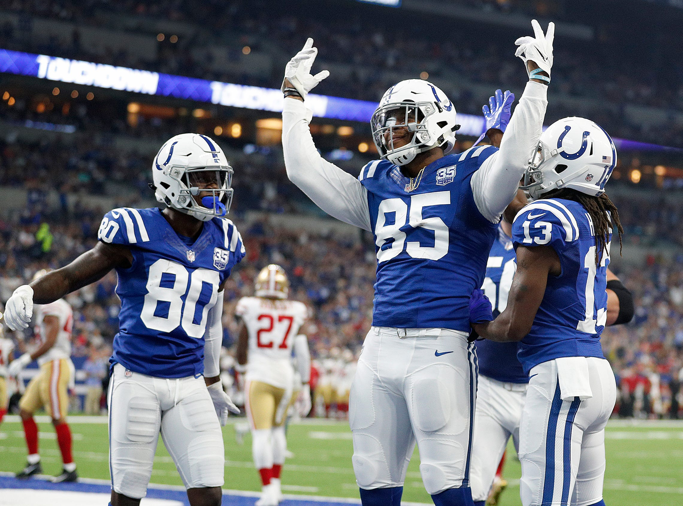 Indianapolis Colts tight end Eric Ebron (85) celebrates his touchdown  in the first half of their preseason football game at Lucas Oil Stadium Saturday, August 25, 2018.