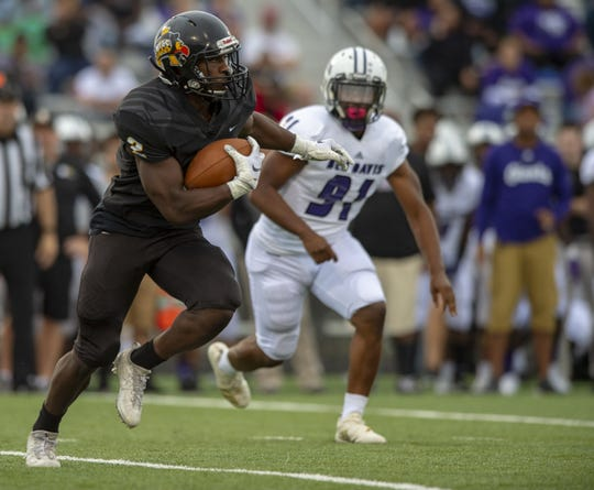 Avon High School senior Sampson James (2) rushes the ball out of the backfield during the first half of action. Avon High School hosted Ben Davis High School in IHSAA varsity football action, Friday, Aug. 24, 2018.