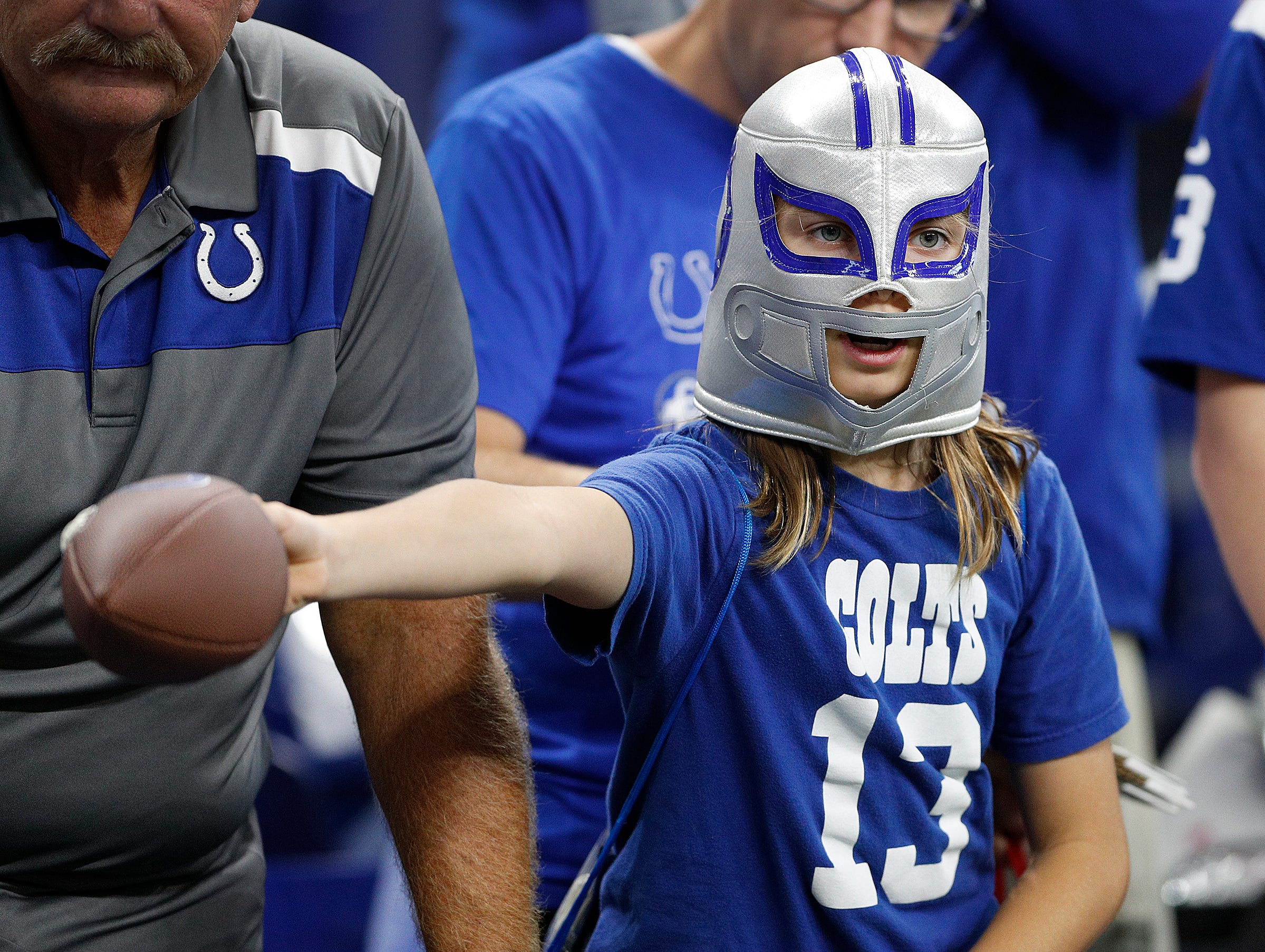 An Indianapolis Colts fan looks for autographs before the the start of the Indianapolis Colts game against the San Francisco 49ers at Lucas Oil Stadium Saturday, August 25, 2018.
