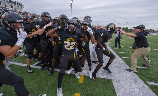 The Orioles celebrate scoring on the team's first play of the game during the first half of action. Avon High School hosted Ben Davis High School in IHSAA varsity football action, Friday, Aug. 24, 2018.