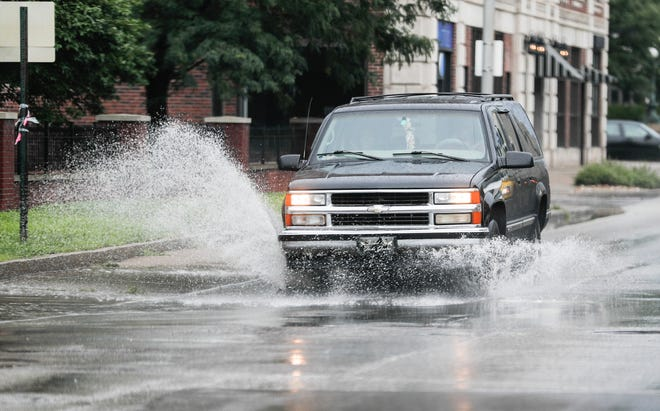 Heavy rain throughout the morning left ground saturated with large puddles along 16th Street in Indianapolis in June. The Indianapolis area also saw a half-inch of rain on Saturday, Aug. 25, 2018.