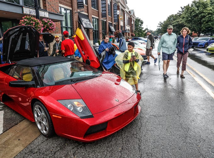 Car And Art Fans Brave The Rain For Artomobilia In Carmel - Carmel indiana car show