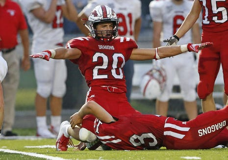 New Palestine defensive back Maxen Hook reacts after breaking up a pass by Center Grove in the first half of the game at New Palestine High School in New Palestine, Ind., Friday, Aug. 24, 2018. The New Palestine Dragons defeated the Center Grove Trojans 31-9.