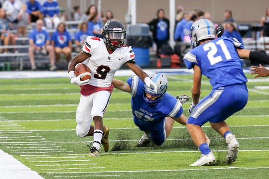 North Central Trevon Elliott (9) tries to find some running room during the first half of Hamilton Southeastern High School vs. North Central High School varsity football held at Hamilton Southeastern High School, August 24, 2018. North Central won 31 to 13.