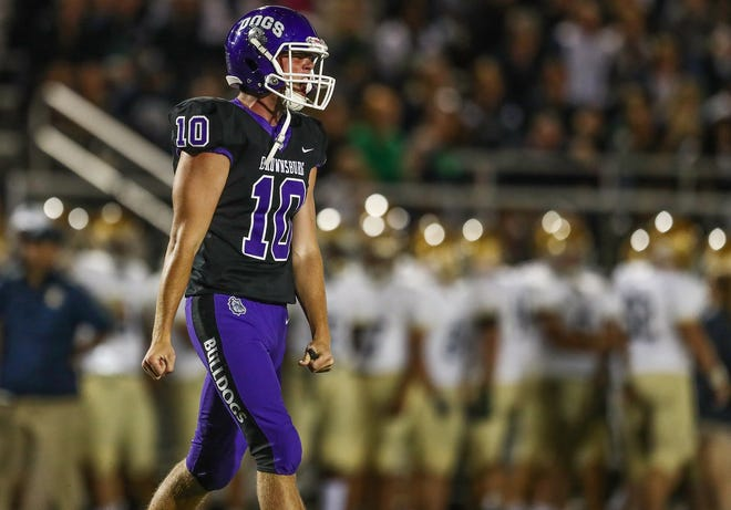 Brownsburg's Ben Easters (10) celebrates after throwing a touchdown pass against Cathedral at Brownsburg High School on Friday, Aug. 24, 2018.
