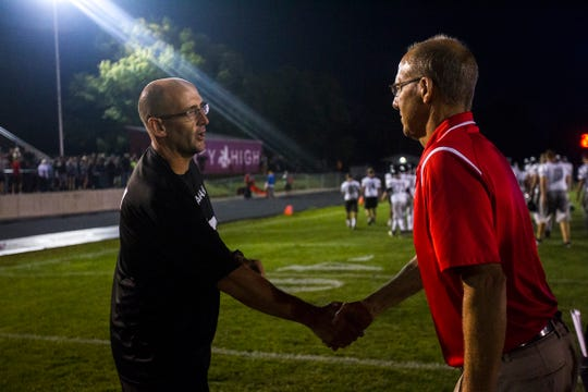 Iowa City Liberty football head coach Jeff Gordon shakes hands with Iowa City High football head coach Dan Sabers after a football game on Friday, Aug. 24, 2018, at Bates Field in Iowa City.