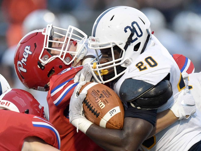 Washington's Kell Hodges (20) tries to run over a Prep defender on Friday, Aug. 24, 2018, at Jackson Prep in Flowood, Miss.