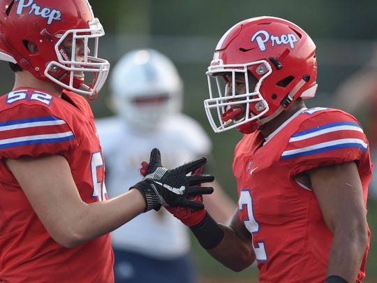 Prep's Jerrion Ealy (2) gets congratulations for his touchdown from teammate Charlie Ott (52) on Friday, Aug. 24, 2018, at Jackson Prep in Flowood, Miss.
