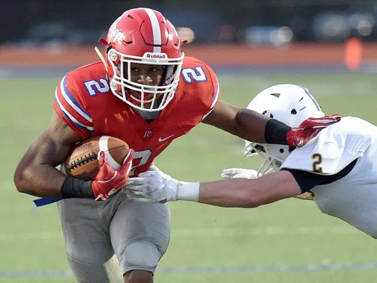 Prep's Jerrion Ealy (left) sheds Washington defender John Bentley Suares enroute to a touchdown on Friday, Aug. 24, 2018, at Jackson Prep in Flowood, Miss.