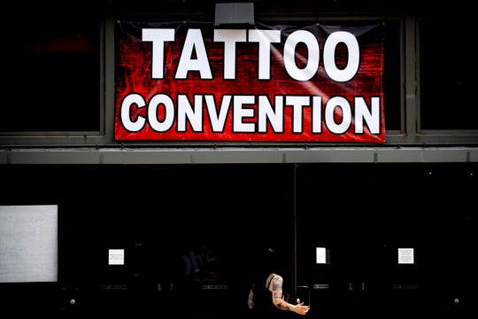 A visitor enters the Knoxville Tattoo Convention inside the Holiday Inn World's Fair Park in Knoxville, Tennessee on Saturday, August 25, 2018. The event also included tattoo contests, live tattooing, vendors, seminars and sideshow performances.
