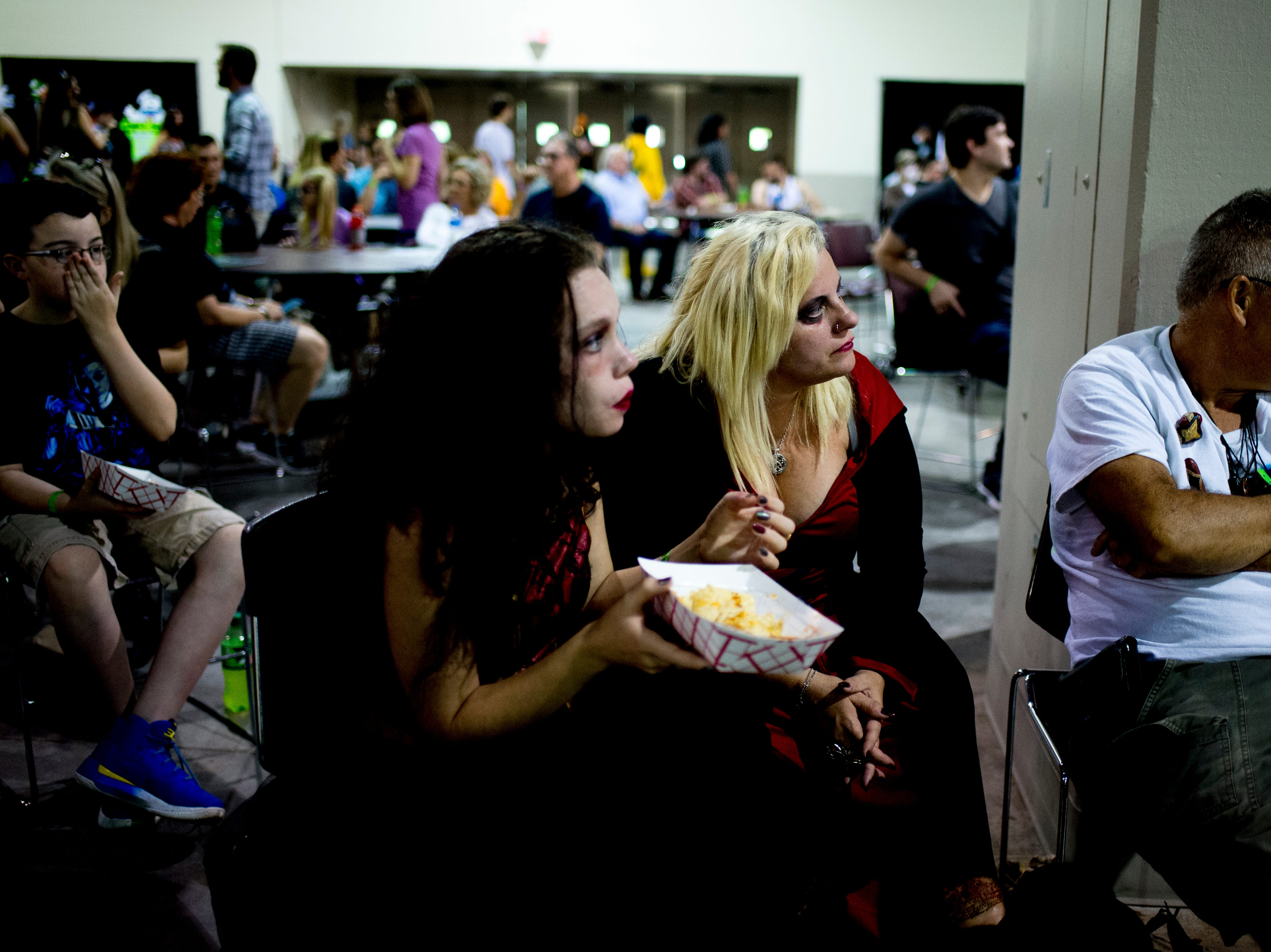 Attendees watch a performance during the annual Knoxville CreepyCon at the World's Fair Exhibition Hall in Knoxville, Tennessee on Saturday, August 25, 2018. The event featured performers, a zombie beauty contest, workshops and a wide selection of vendors.