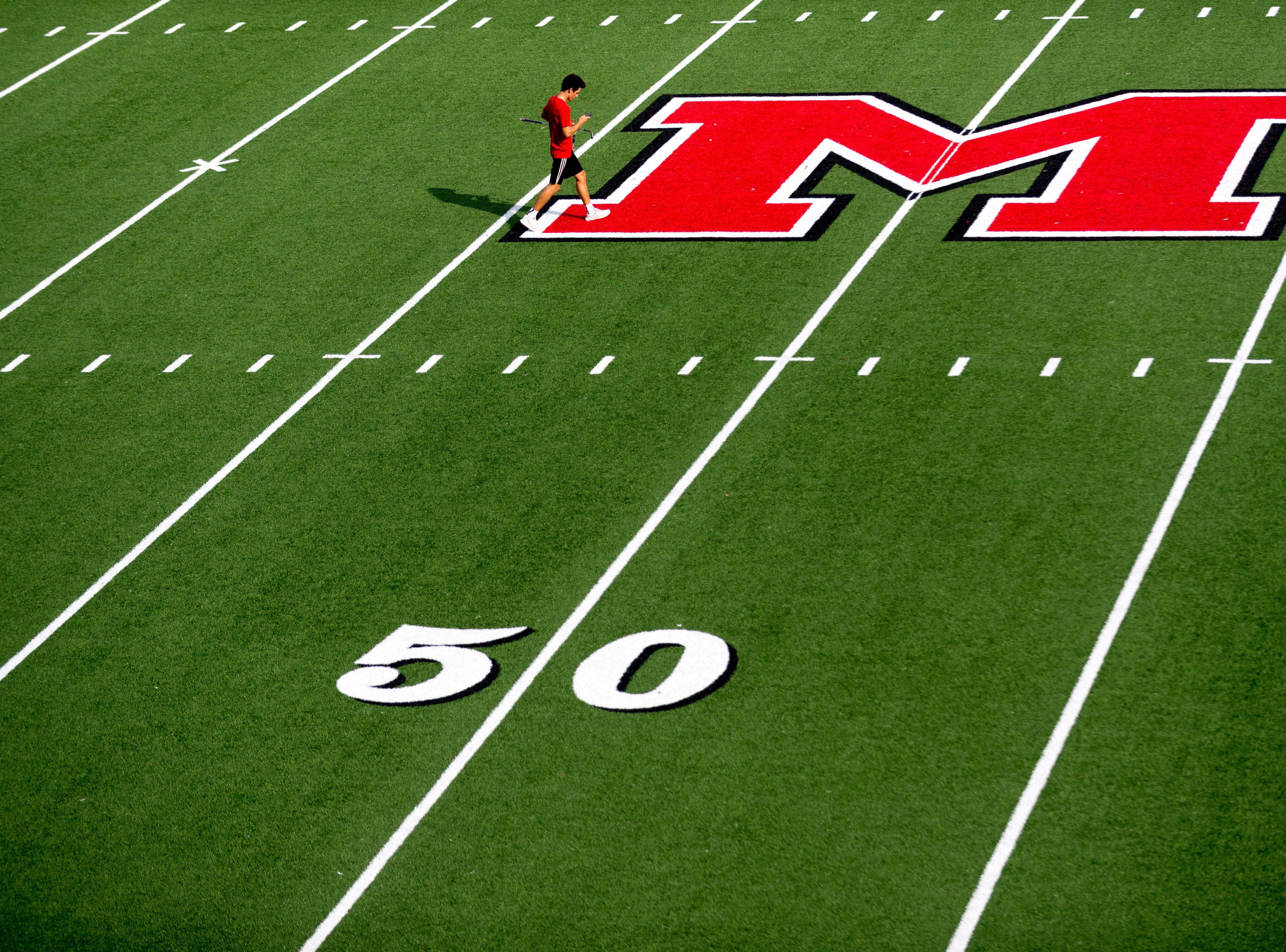 A Maryville team member walks across the field during a football game between Maryville and Oakland at Maryville High School in Maryville, Tennessee on Friday, August 24, 2018.