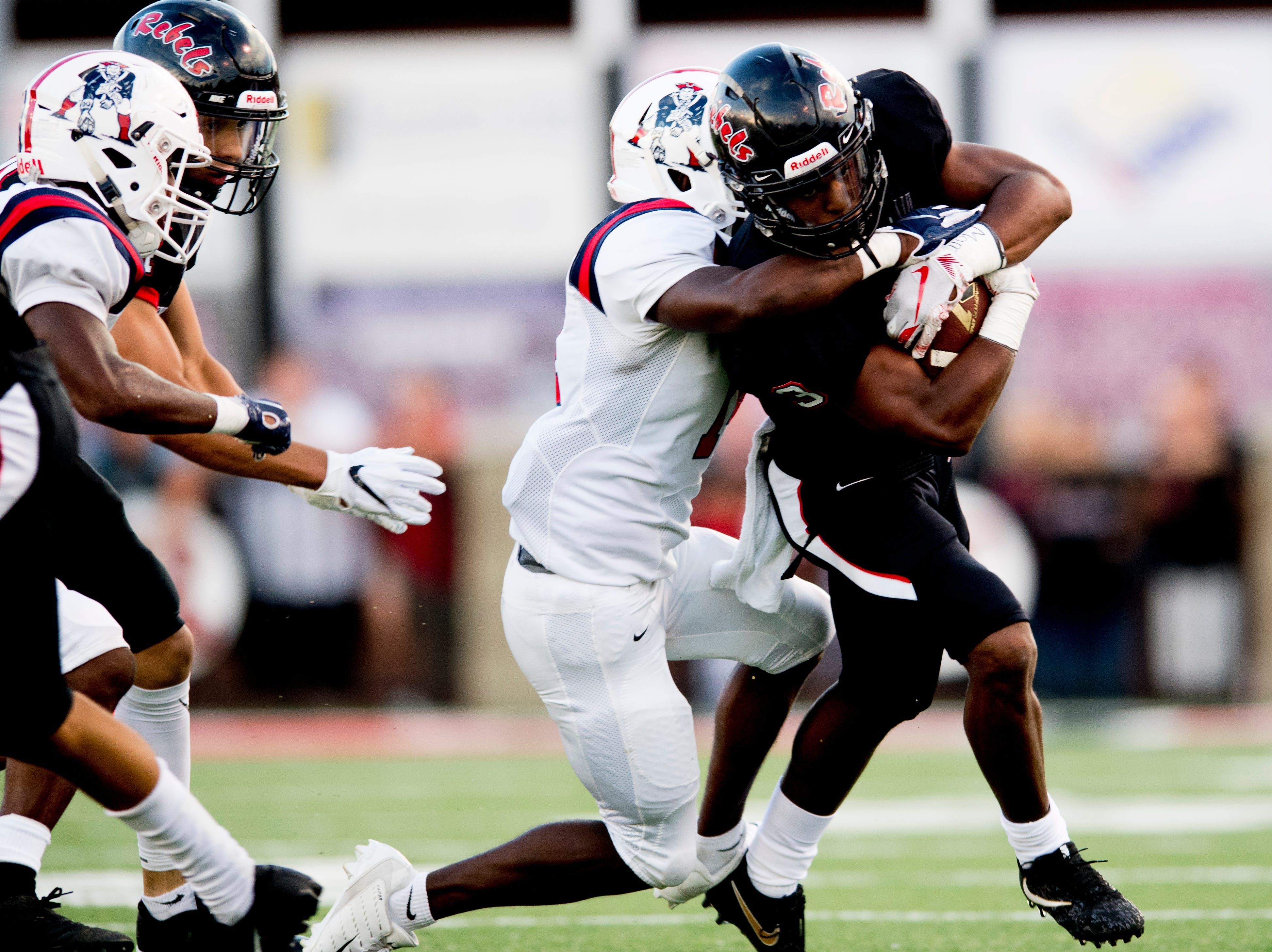 Maryville's A.J. Davis (3) is taken down by an Oakland player during a football game between Maryville and Oakland at Maryville High School in Maryville, Tennessee on Friday, August 24, 2018.