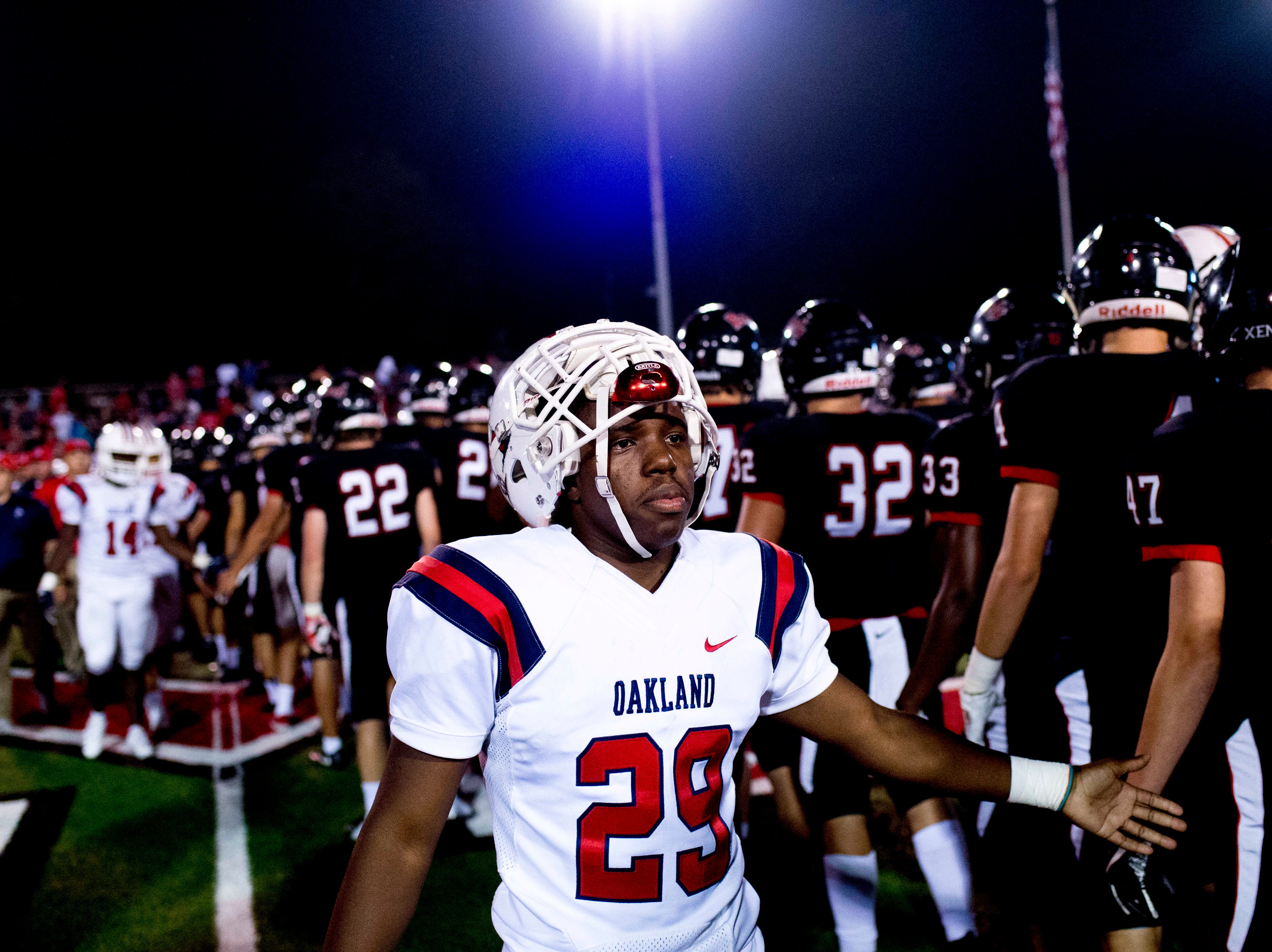 Oakland's Antonio Lee (29) congratulates Maryville after Oakland's loss during a football game between Maryville and Oakland at Maryville High School in Maryville, Tennessee on Friday, August 24, 2018.