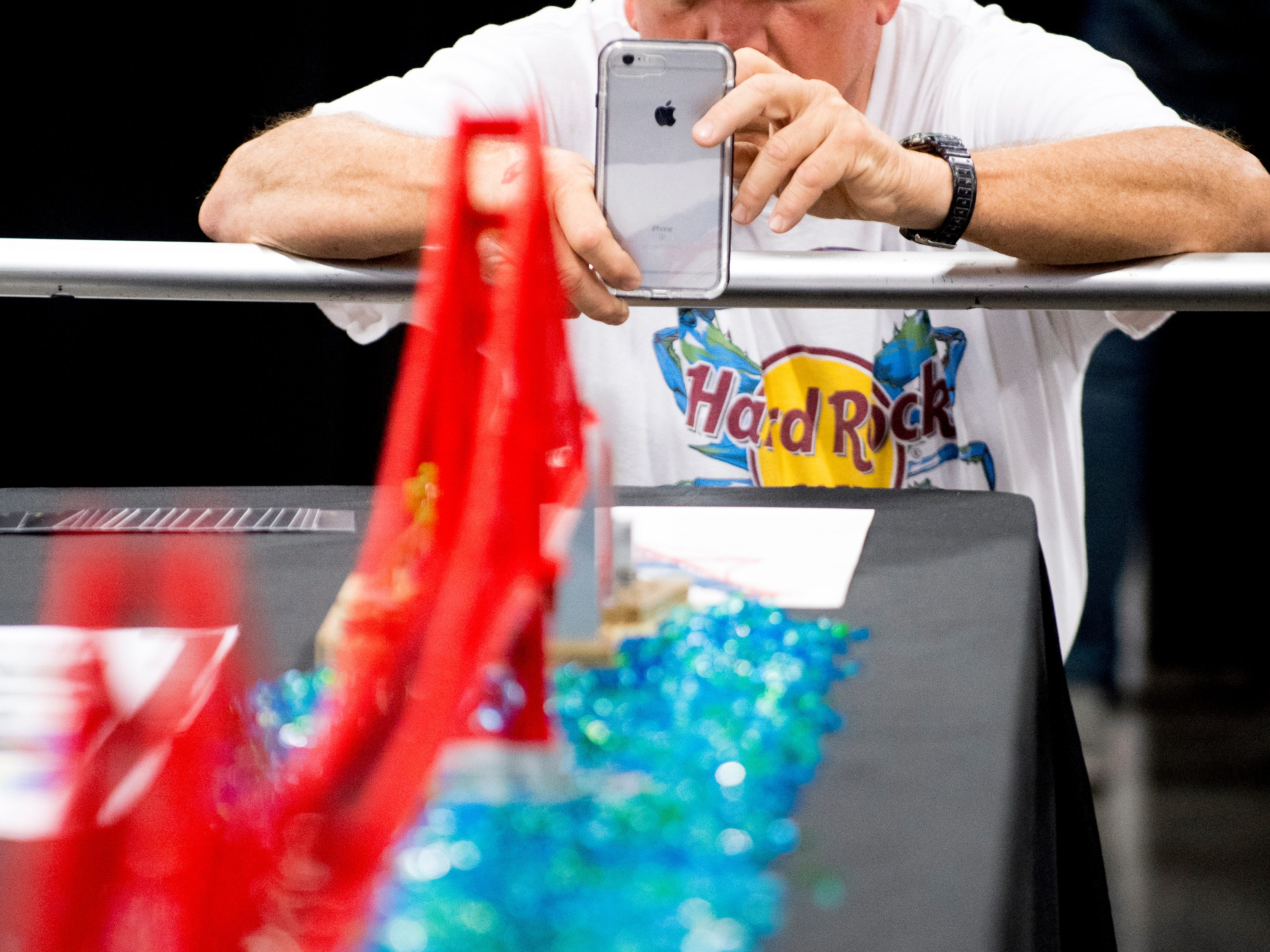 Paul Hardtke, of Asheville, North Carolina, takes a photo of Golden Gate Bridge while visit with his son and grandson at the BrickUniverse Knoxville LEGO Fan Expo in the Knoxville Convention Center in Knoxville, Tennessee on Saturday, August 25, 2018. Life-sized LEGO displays, over 40 world landmarks build to-scale from LEGO as well as castles, trains, and cities and other creations were on display.