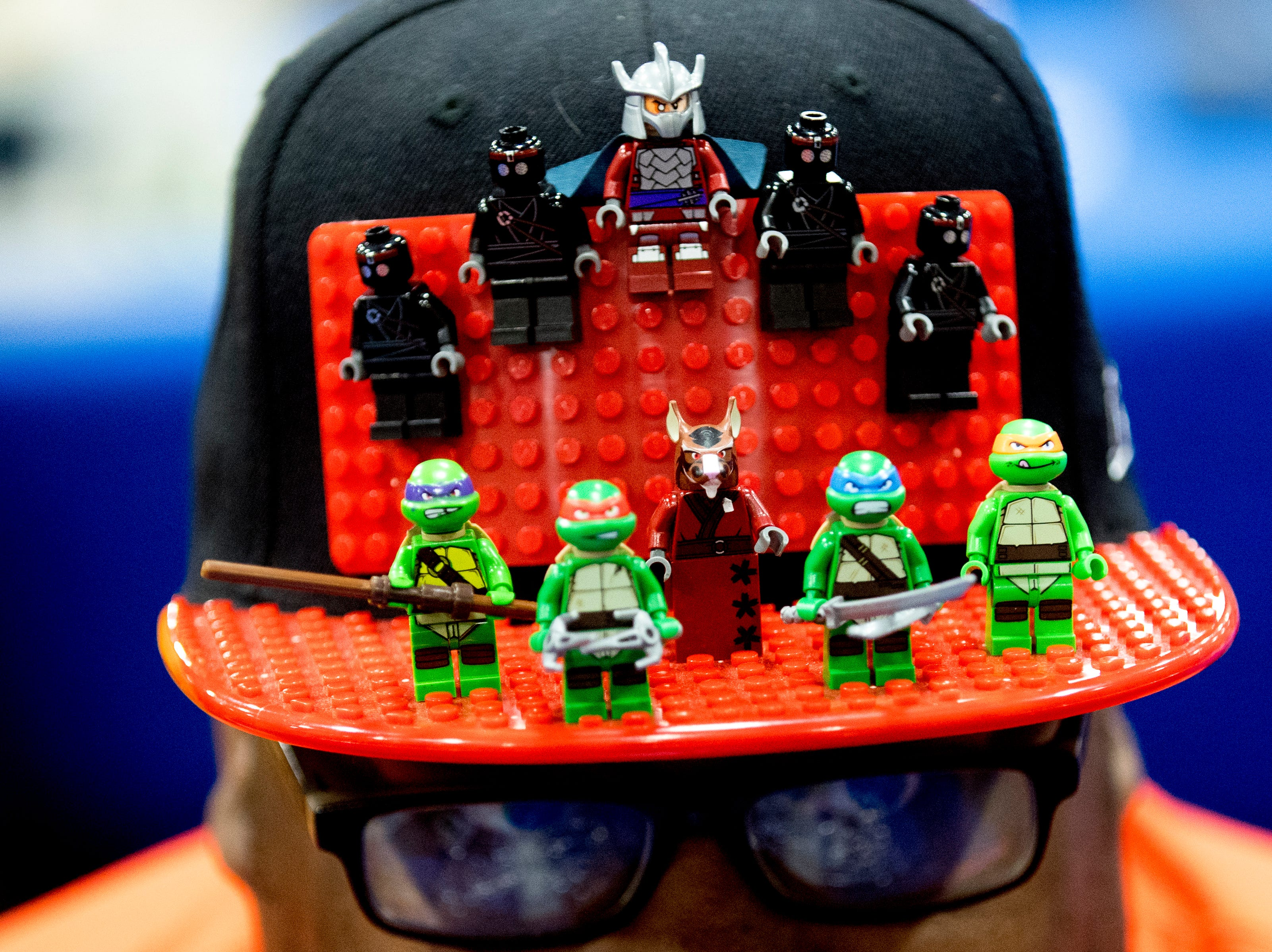 Tennessee Valley LEGO Club member Willie Neblett Jr., of Nashville, shows off his decorative cap at the BrickUniverse Knoxville LEGO Fan Expo in the Knoxville Convention Center in Knoxville, Tennessee on Saturday, August 25, 2018. Life-sized LEGO displays, over 40 world landmarks build to-scale from LEGO as well as castles, trains, and cities and other creations were on display.