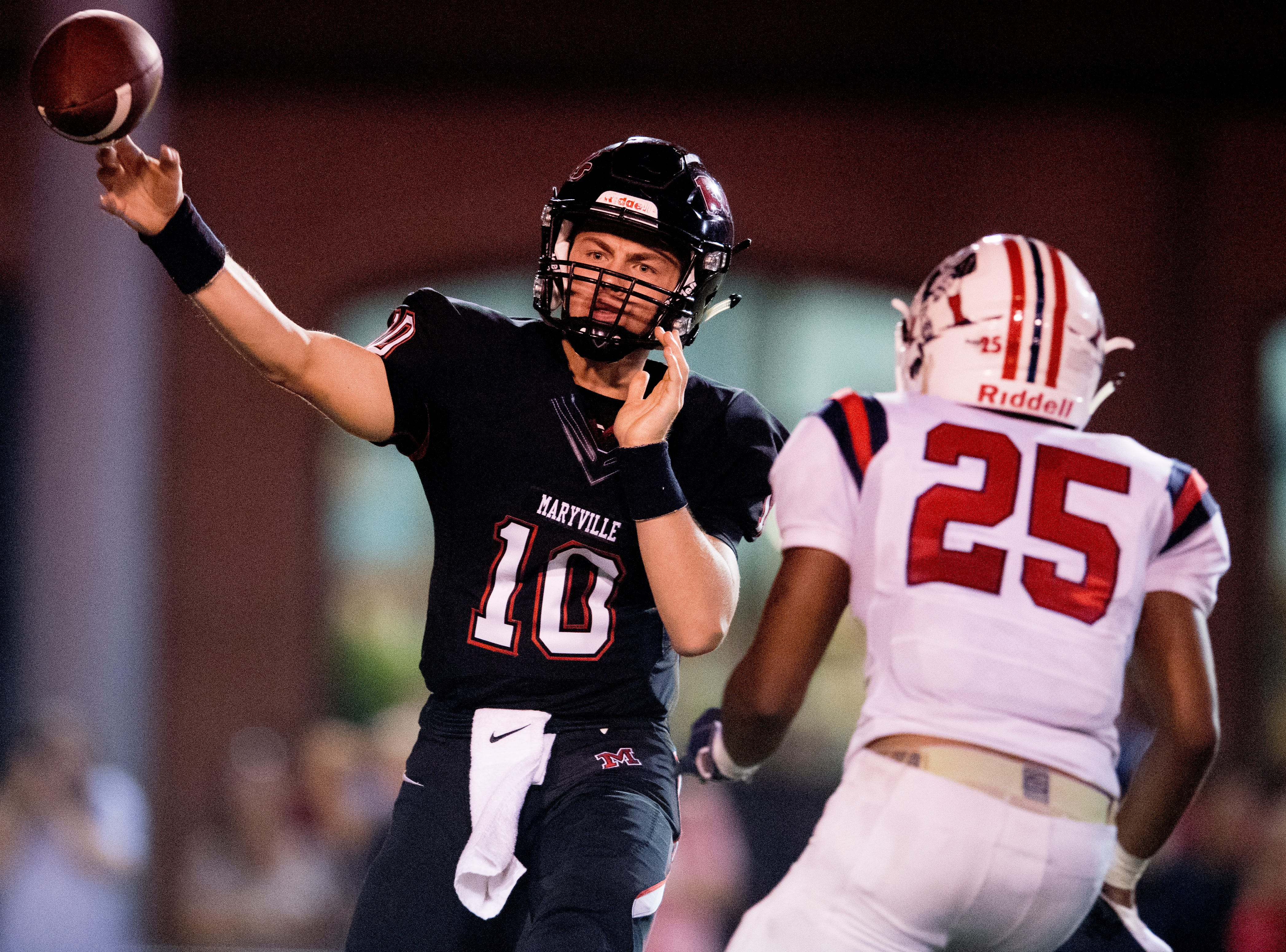 Maryville's Braden Carnes (10) throws a pass past Oakland's Tim Pannell (25) during a football game between Maryville and Oakland at Maryville High School in Maryville, Tennessee on Friday, August 24, 2018.