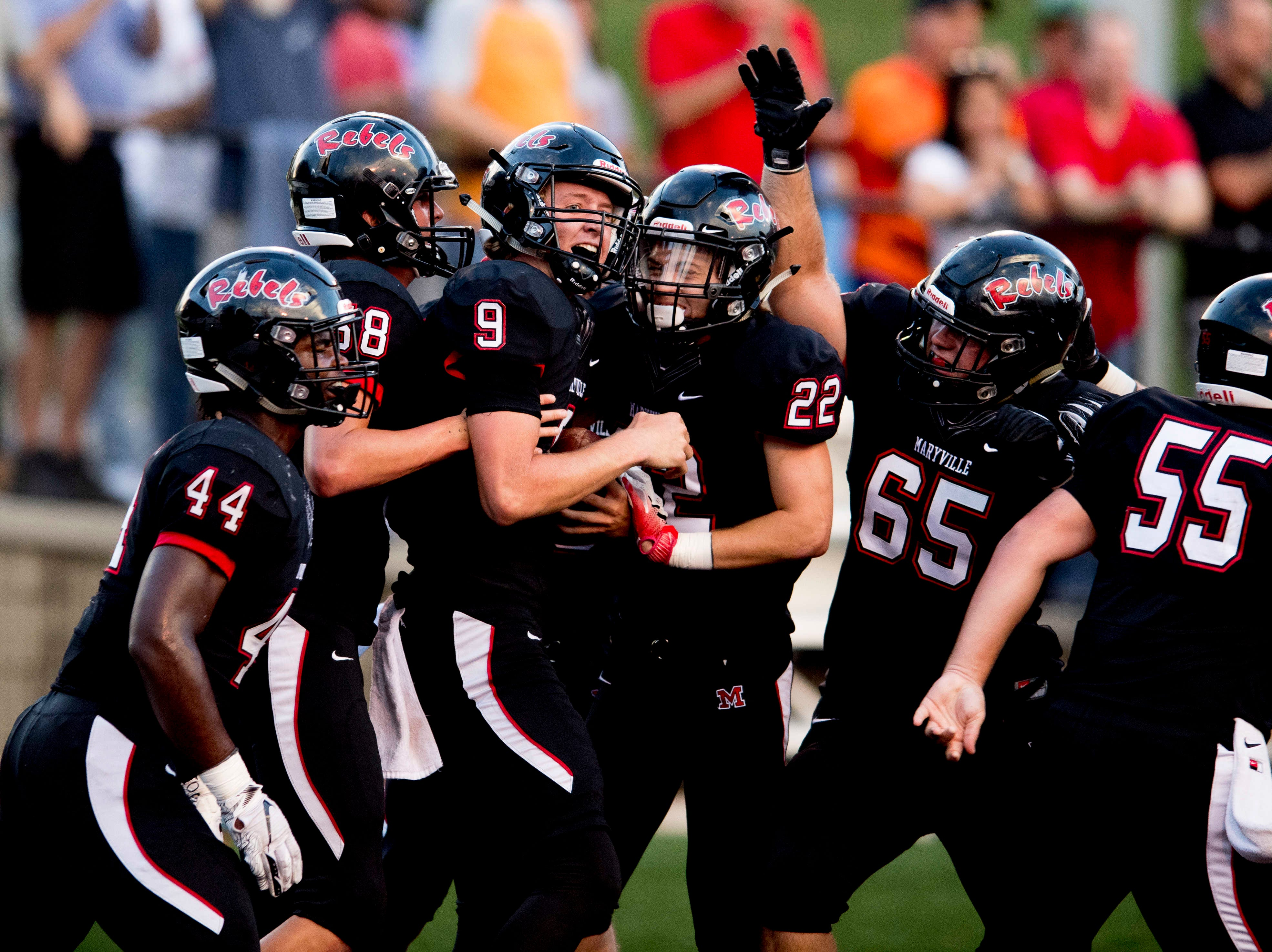 Maryville's Cade Chambers (9) is congratulated by team members after running a touchdown during a football game between Maryville and Oakland at Maryville High School in Maryville, Tennessee on Friday, August 24, 2018.